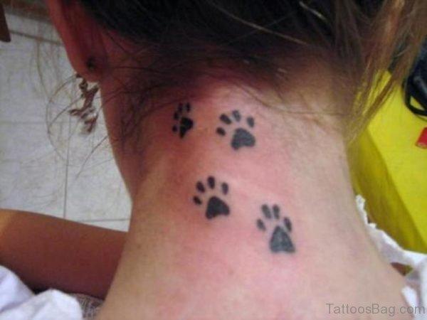 Four Paw Print Tattoo On Wrist