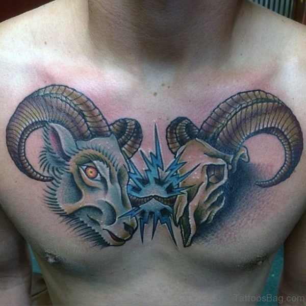 Gentleman With Bucking Aries Ram Skull Chest Tattoo
