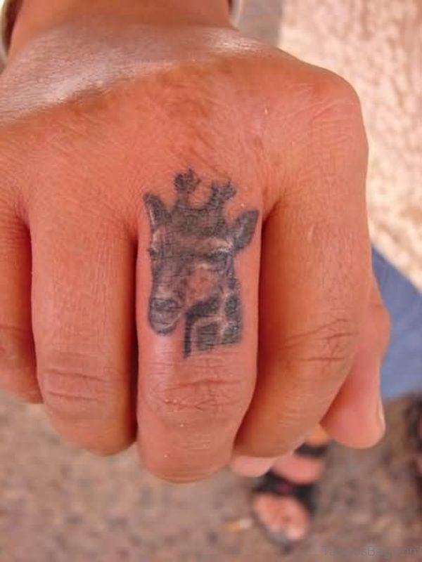 Giraffe Head Tattoo On Middle Finger