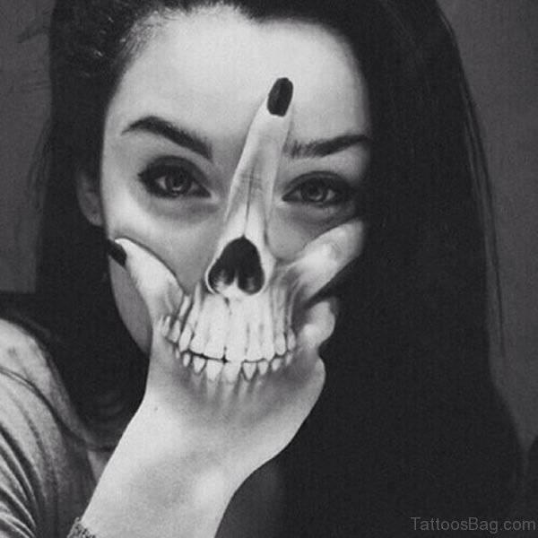 Girl Showing Her Skull Tattoo