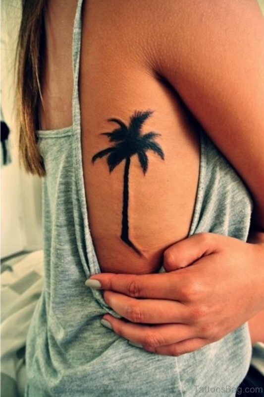 Girl With Palm Tree Tattoo On Rib Side
