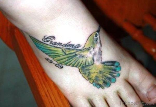 Green Bird Tattoo On Foot