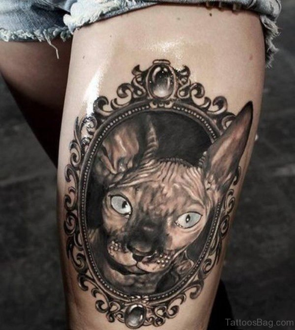 Green Eye Cat Tattoo On Thigh