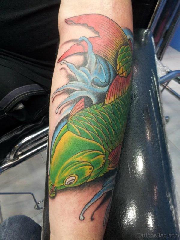 Green Fish Tattoo On Arm