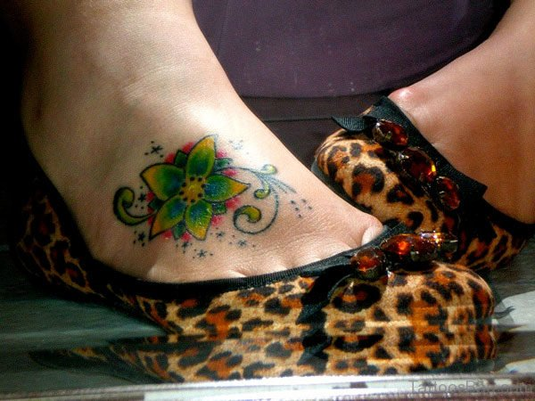Green Flower Tattoo On Foot