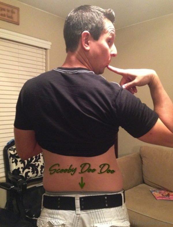 Green Ink Arrow Tattoo