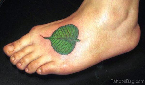 Green Leaf Tattoo On Foot