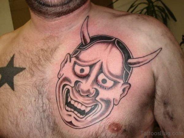 Grey Devil Mask Tattoo