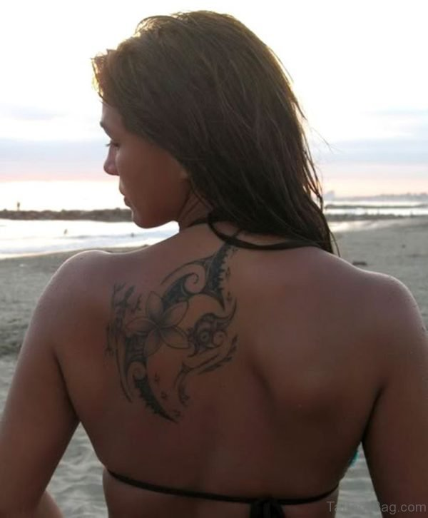 Grey Flower Tattoo On Upper Back