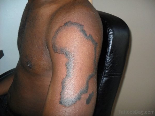 Grey Ink African Map Tattoo On Shoulder