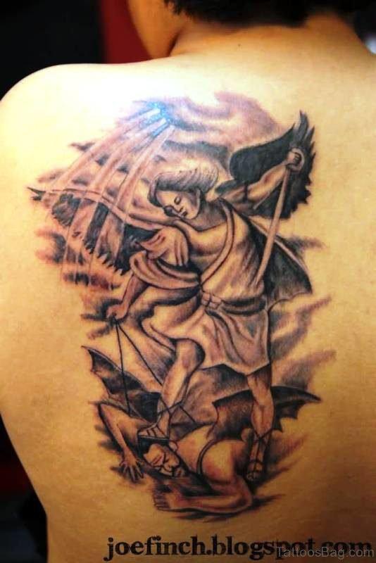 Grey Ink Archangel With Devil Tattoo