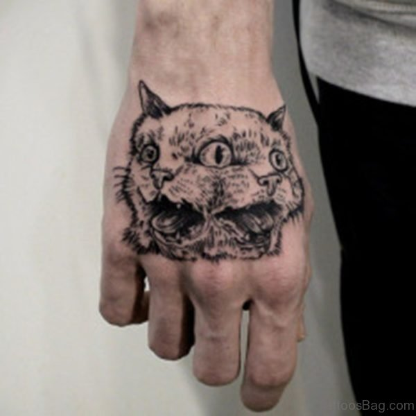Grey Ink Cat Tattoo