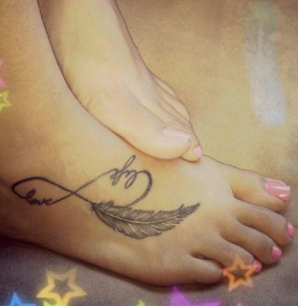 Grey Ink Feather And Infinity Tattoo On Right Foot