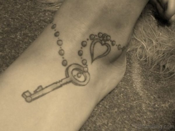 Grey Ink Key And Heart Tattoo On Ankle