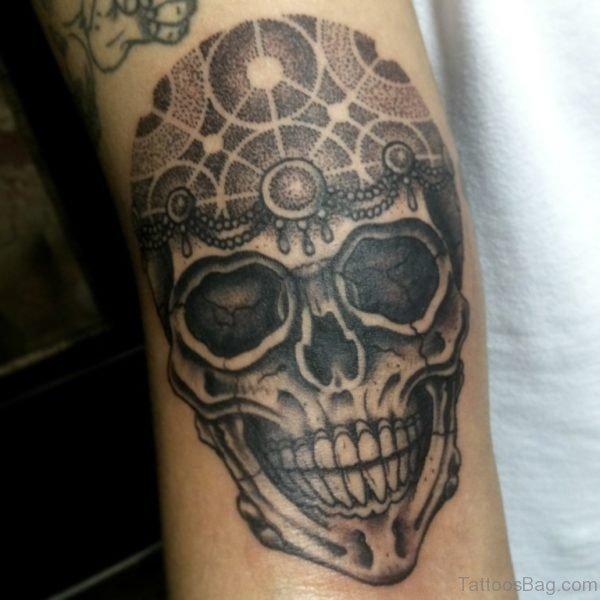Grey Ink Skull Tattoo On Arm