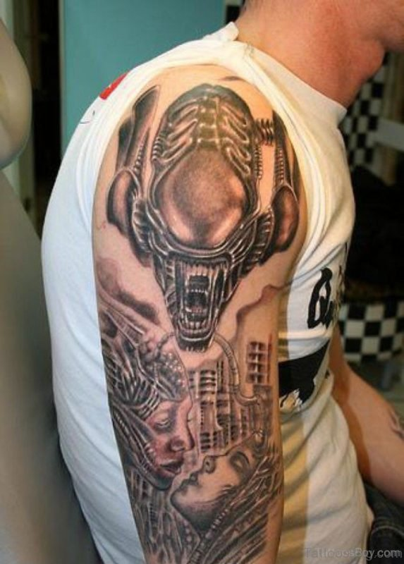 Grey Inked Alien Tattoo On Shoulder