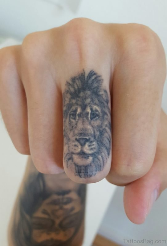 Grey Lion Tattoo On Finger