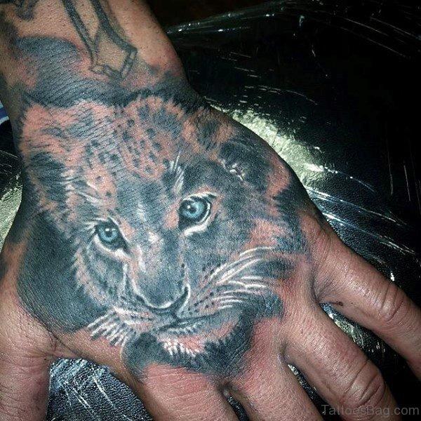 Grey Lion Tattoo On Hand