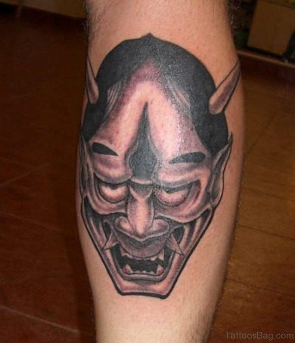 Grey Mask Tattoo On Leg