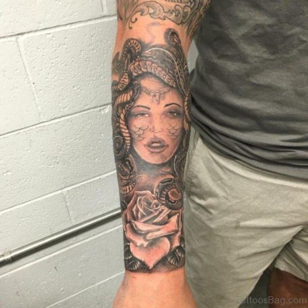 Grey Medusa Tattoo On Arm