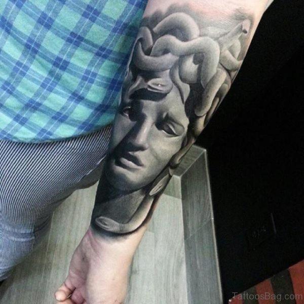 Grey Medusa Tattoo On Wrist
