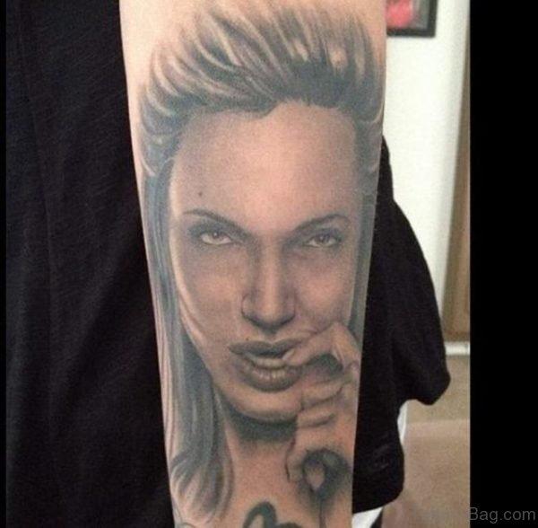 Grey Portrait Tattoo On Arm