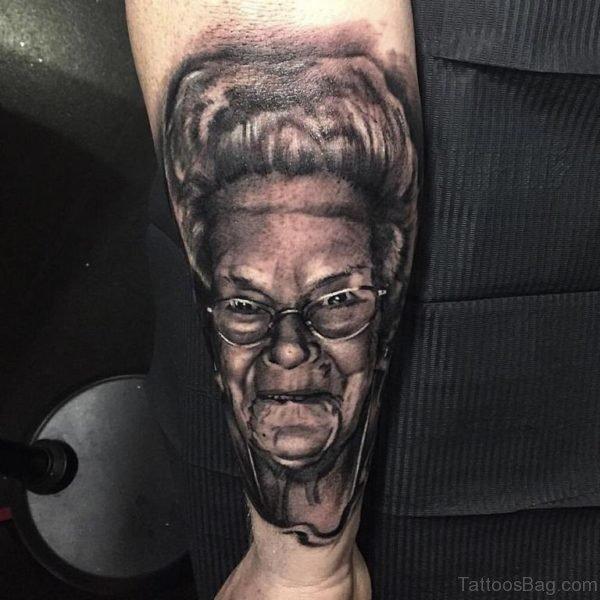Grey Portrait Tattoo On Wrist