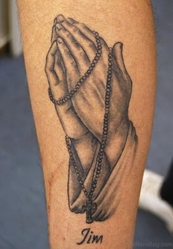 Grey Praying Hands And Rosary Tattoo