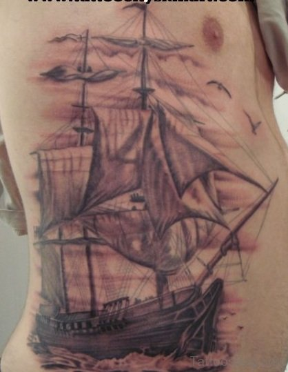 Grey Ship Tattoo On Rib