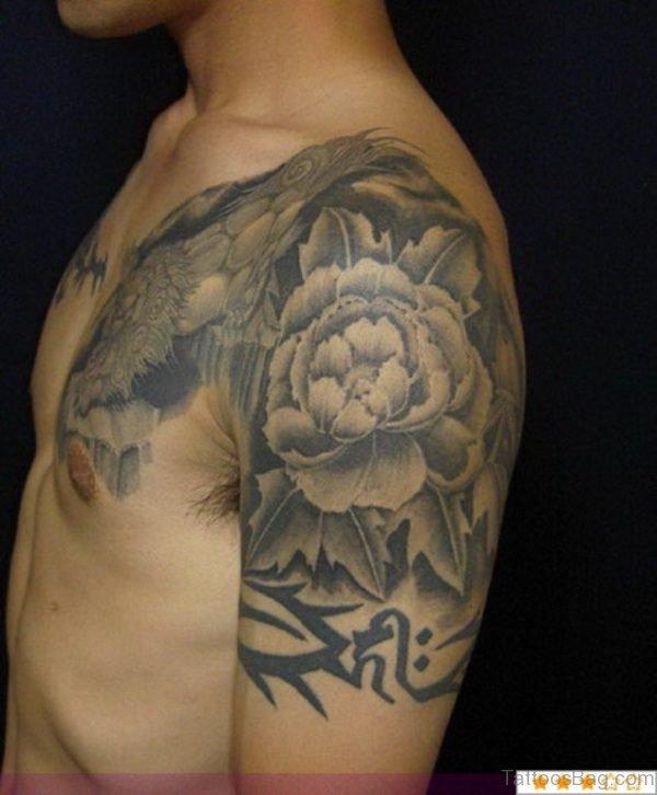 Grey Tribal Shoulder Tattoo
