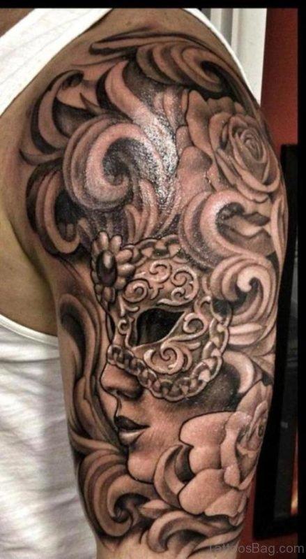 Grey Venetian Mask Tattoo On Shoulder