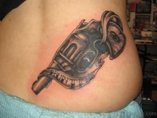 Gun Tattoo On Lower Back
