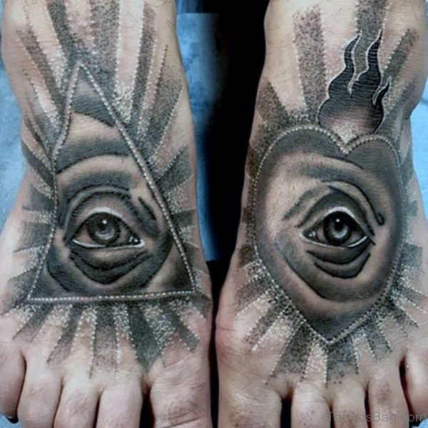 Guy With Shiny Eye Tattoo On Foot