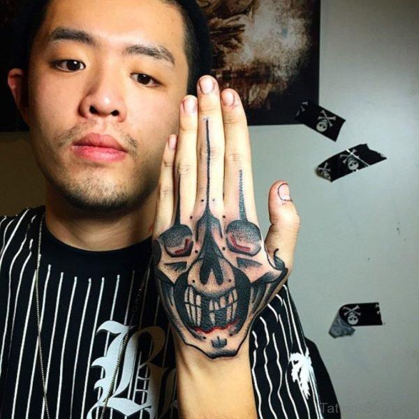 Hand Skull Tattoo Design