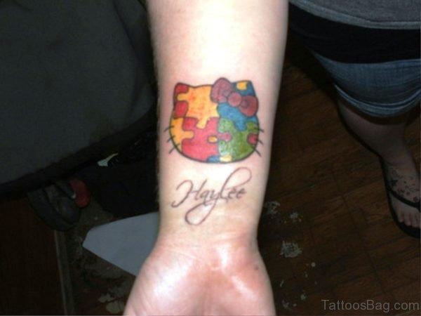 Hello Kitty Autism Tattoo On Wrist