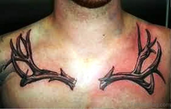 Image Of Antler Tattoo On Chest