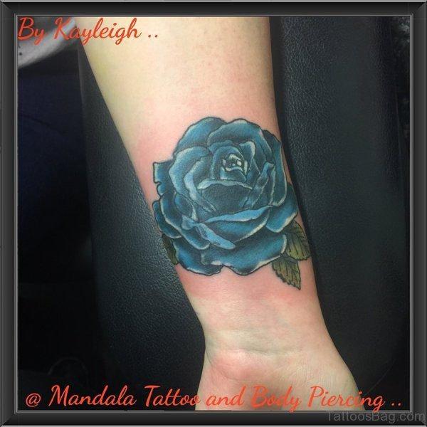Impressive Blue Rose Wrist Tattoo