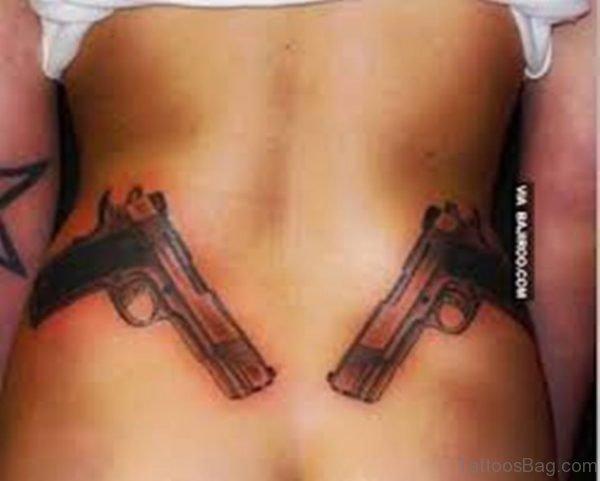 Impressive Gun Tattoo On Waist
