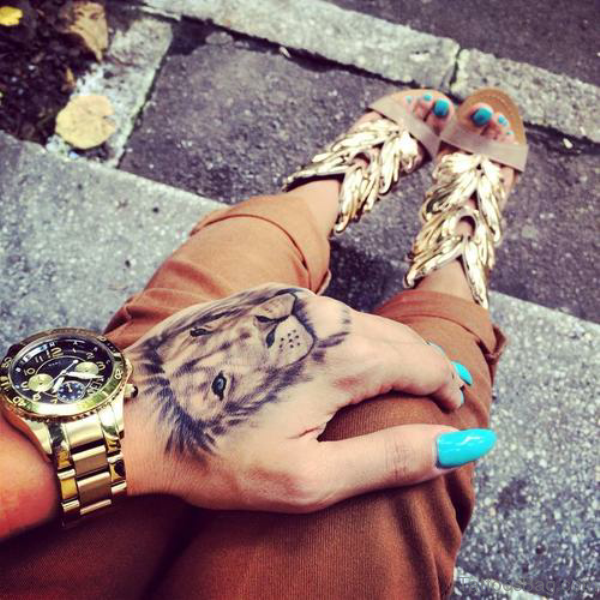 Impressive Lion Head Tattoo On Hand