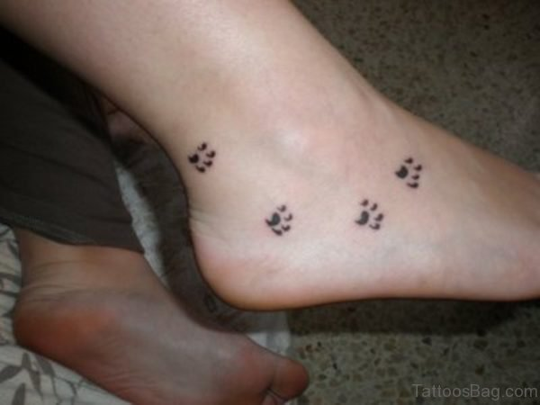 Impressive Paw Tattoo On Foot