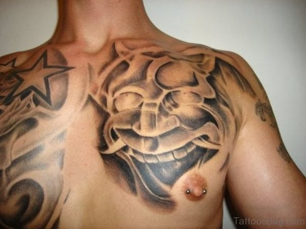 Japanese Mask And Star Tattoo Designs On Chest