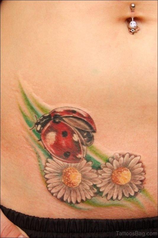 Ladybug And Flower Tattoo