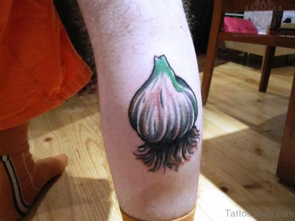 Large Garlic Tattoo On Calf