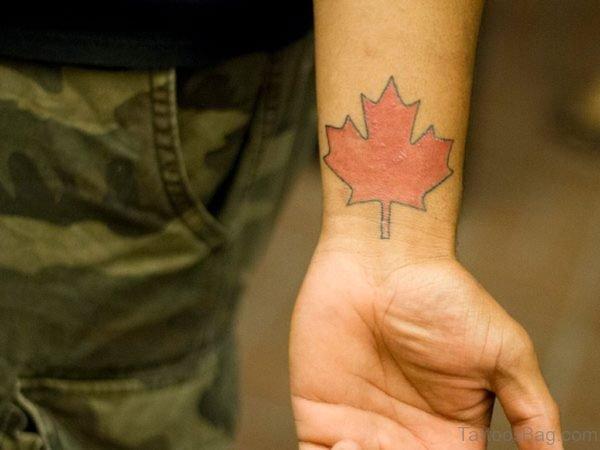 Large Orange Leaf Wrist Tattoo