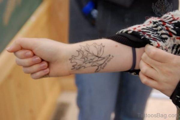 Light Grey Leaves Wrist Tattoo