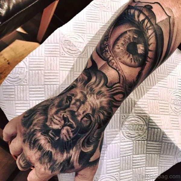 Lion With Eye Tattoo On Hand