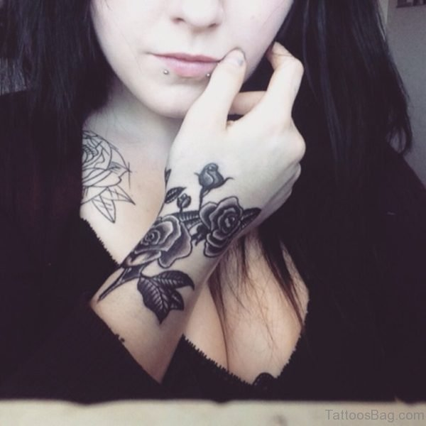Lip Piercing And Flower Tattoo
