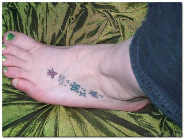 Little Star And Butterfly Tattoo