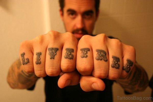 Live Free Tattoo On knuckle