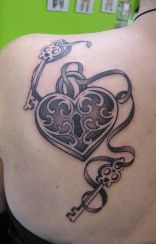 Lock And Key Tattoo On Back